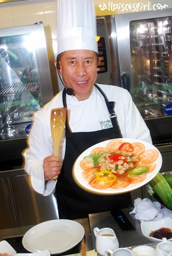 Chef Martin Yan posing with Stir-fried Chicken