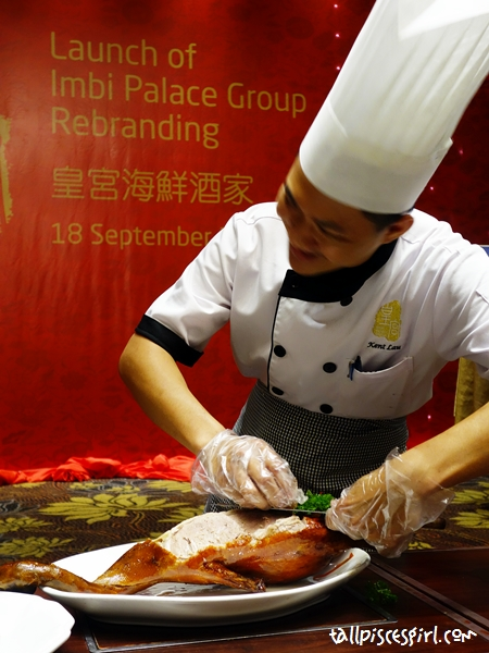 Chef showed how he slices off the duck skin and meat