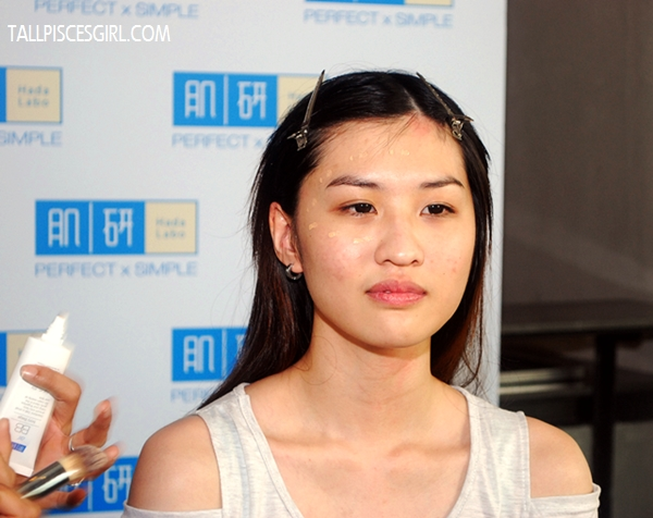 Before Air BB Cream was applied, there were some red spots on her face
