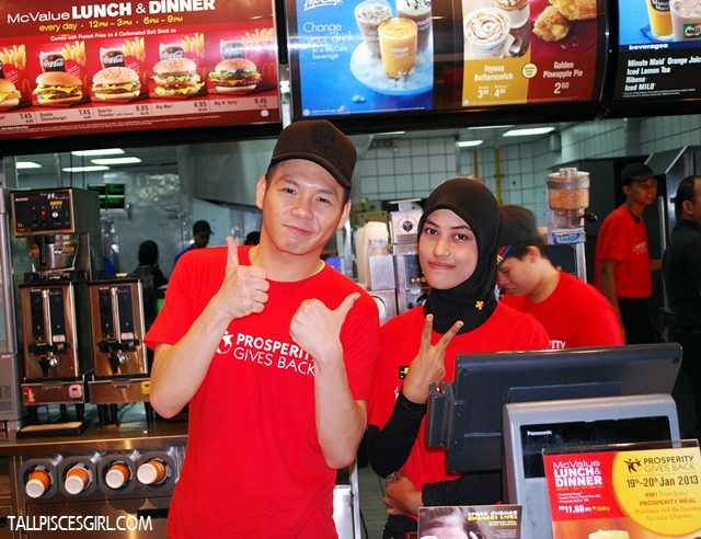 Nicholas Ong teaming up with cashier staff. Who wants to order from this leng chai? :D