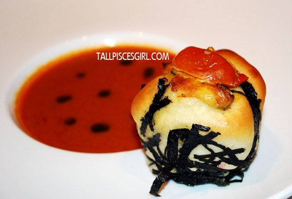 Roasted Tomato Basil Oil Soup Served with Herbs Bread Rolls with Butter