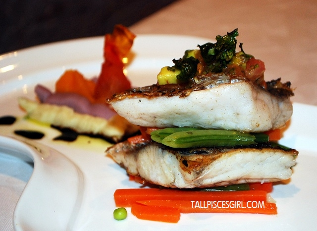 Pan Fried Sea Bass Fillet with Balsamic Drizzle served with Tri Color Sweet Potato Mash and Avocado Tomato Salsa & Green Pepper Corn Foam