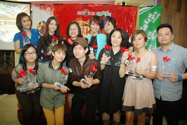 Local artistes and representatives with their awards