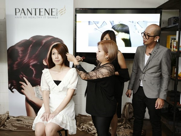 Founder of Hair Atelier, Aaron Yap together with his leading creative stylist, Barney demonstrating a series of hair styles with colored and permed hair.