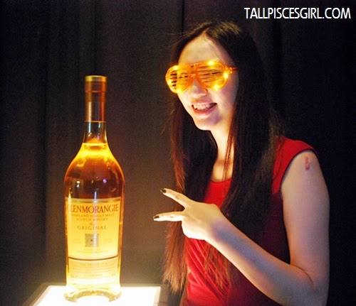 It's my pleasure to stand beside this huge Glenmorangie bottle!