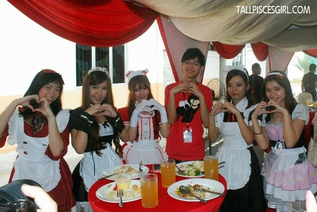 Joel with the maid cosplayers