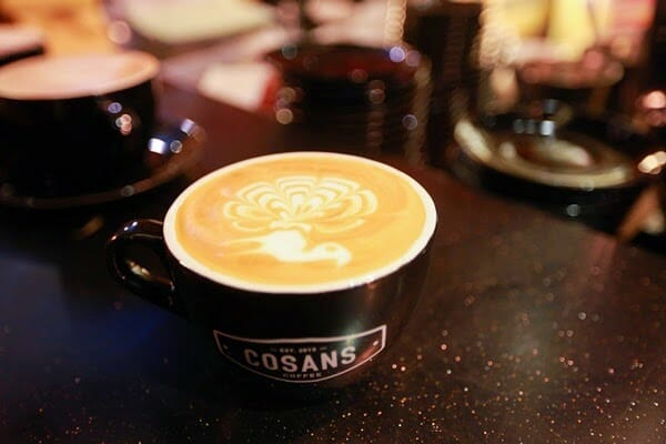Beautiful peacock coffee art prepared by COSANS coffee barista