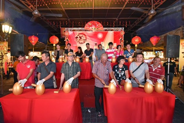 "15 winners striking the golden eggs to unveil their prizes during Tiger Beer's ""Celebration of Golden Prosperity"" on-ground event"