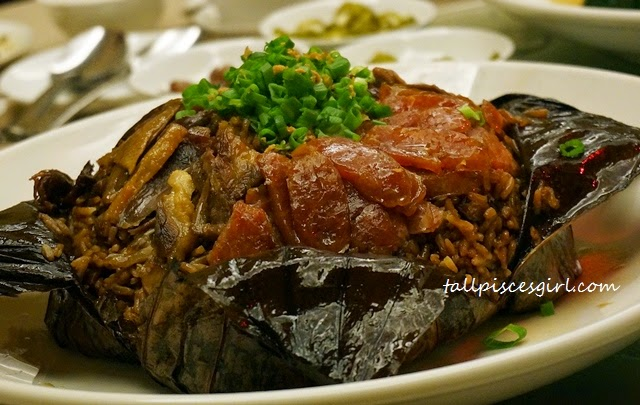 Steamed Rice with Preserved Meat and Diced Duck Wrapped in Lotus Leaves (荷叶腊味饭)