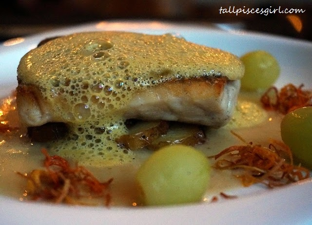 Pan fry seabass, sauteed cocktail potatoes and grapes, lemon grass sauce and ginger and mint emulsion
