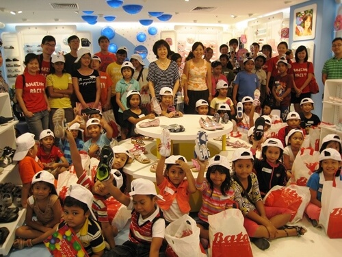 Distribution of shoes to the underprivileged children of Bukit Merah