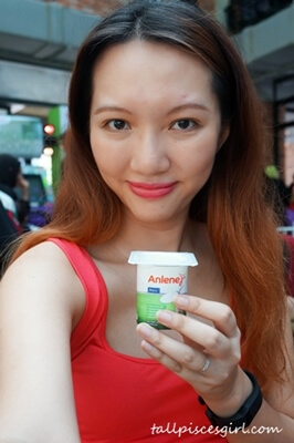 Indulging in Anlene Movemax Yoghurt after the physical tests