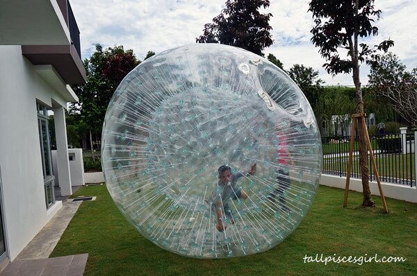Clumsy Boy playing zorb ball