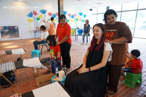 Neck and shoulders massage performed by blind masseurs