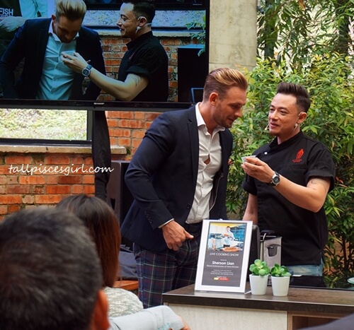 Celebrity chef and Verra Kitchen ambassador, Sherson Lian is showing a foreign guest how belacan smells like