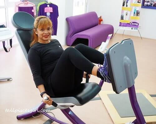 Kak Ella exercising on the leg press machine