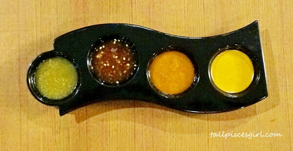 Special dipping sauce (L-R: Lime Chili Sauce, Black Pepper Sauce, Massaman Sauce, Sanoook Sauce)
