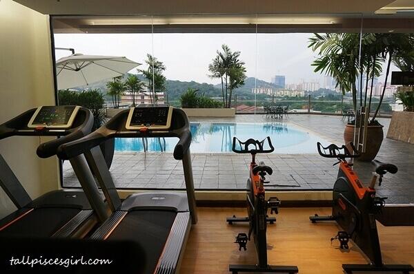 Gymnasium overlooking swimming pool