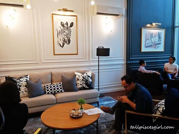 Spacious lounge in the co-working space that exudes class
