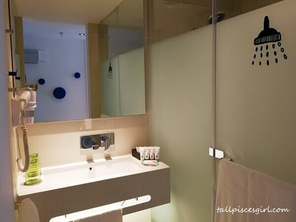 The basin and shower area in Quad Room