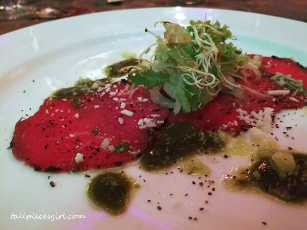 Second appetizer: Beef Carpaccio, Fennel and Orange, Green Shisho Leaf with Oil Pesto Vinaigrette
