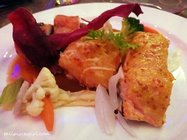 Main course: Combination of Oven Baked Salmon with Garlic Paste and Chicken Roulade served with Potato Dauphinoise, Vegetable and Mushroom Sauce