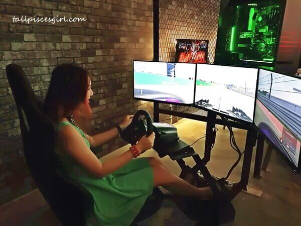 Yours truly trying out the Racing Simulator at The Pantheon @ One Space One CIty