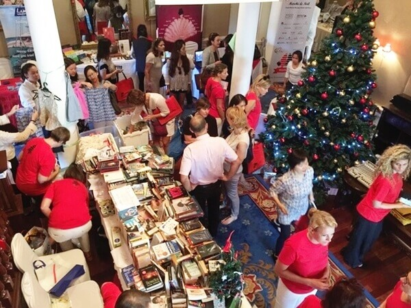 Joyful scene of crowd at Le Marche de Noel 2015 Christmas charity bazaar