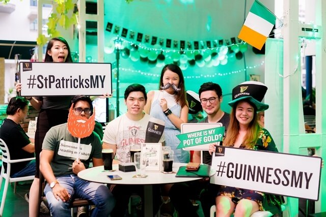 Guests at the GUINNESS St Patrick's Event at SOULed OUT posing with photo props