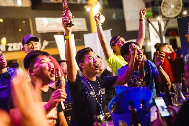 Guests cheering at Tiger Beer's first football viewing party at The Beer Factory, Sunway Giza