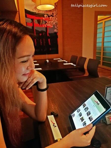Browsing through their digital menu