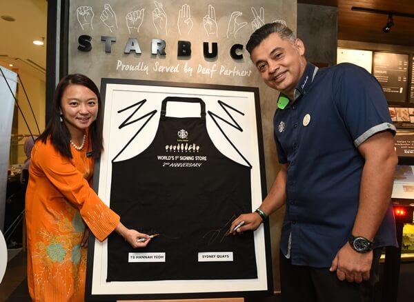 Yang Berhormat Puan Hannah Yeoh and Mr. Sydney Quays CEO of Berjaya Food Berhad and Managing Director of Starbucks Malaysia & Brunei celebrating the world's first Starbucks Signing Store 2nd Anniversary