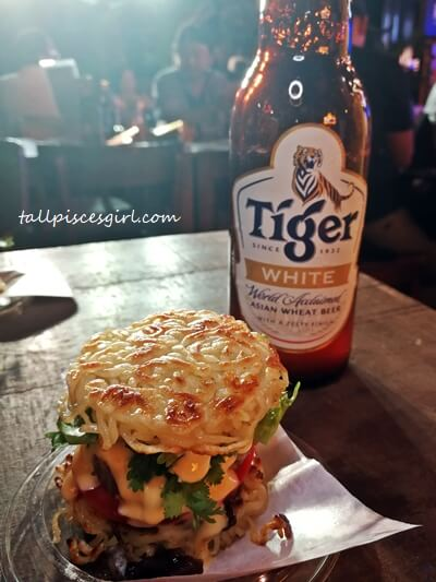 Ramen burger with Tiger Beer and cheddar sauce