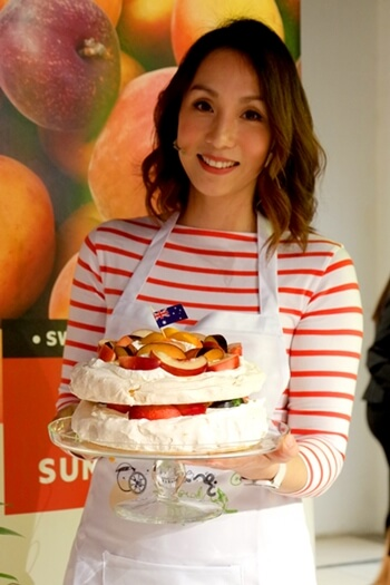 Belinda Chee Holding Her Creation, Pavlova with Summer Fruits