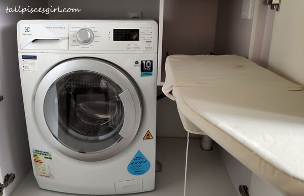 Washing machine and ironing board