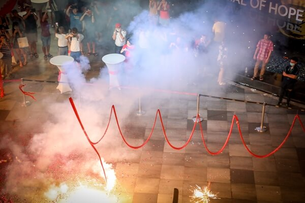 Lighting up firecrackers to celebrate Chap Goh Meh