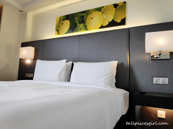 King size bed in King Deluxe Room Lake View